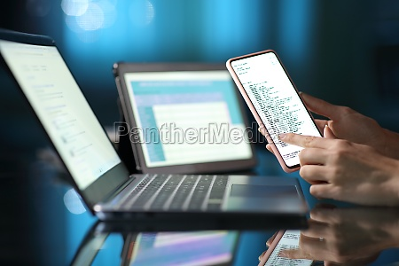 woman hand using multiple devices at