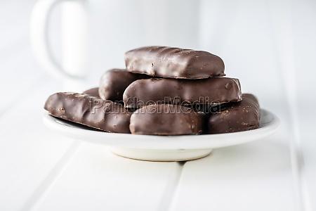 sweet chocolate bars on white plate