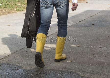 walking in waterproof rubber boots
