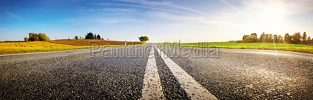 wide asphalt road panorama in countryside