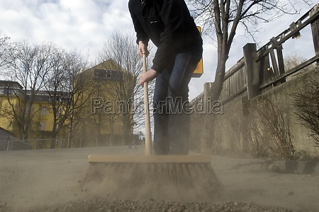 street cleaning with a broom
