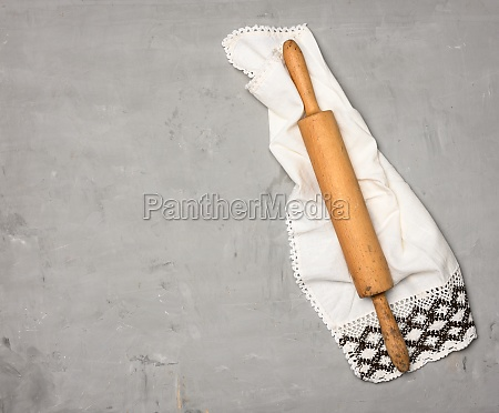 wooden rolling pin on gray background