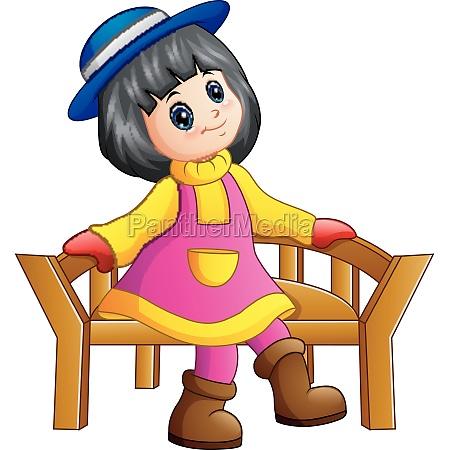 beautiful little girl sitting on wooden