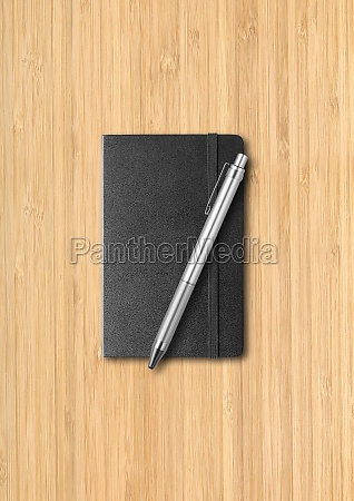 black closed notebook with a pen