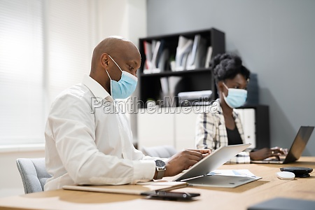team employees wearing covid face mask