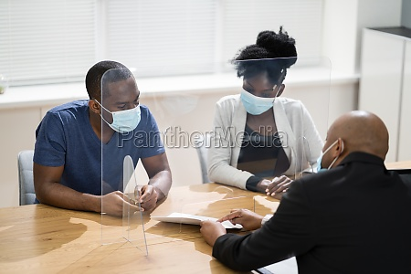 customer in face mask consulting lawyer