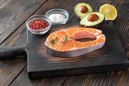 salmon steak on the wooden board