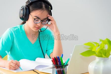 asian woman serious reading a book