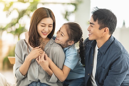 happy family smiling and hugging on