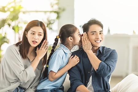 happy family and child whispering gossip