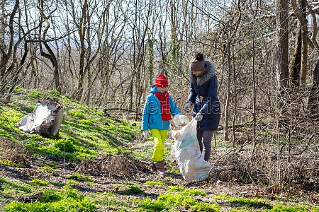 family collects trash in the forest