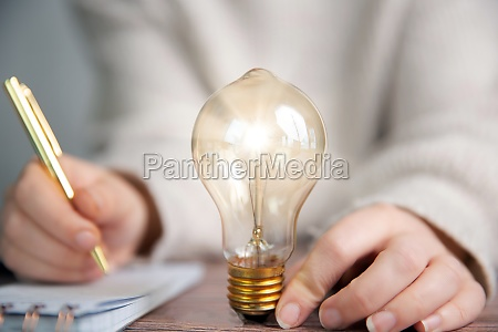 business person writing notes ideas creative