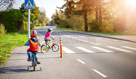 cute children riding on bicycles on