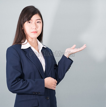 woman in suit open hand palm