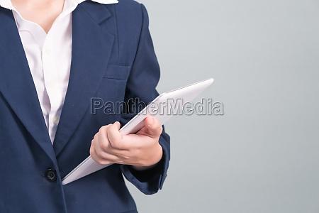 woman in suit using computer digital