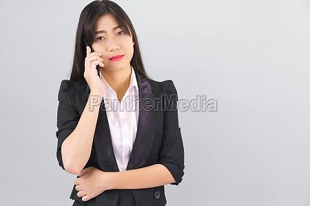 asian women in suit standing posing