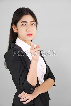 woman in suit looking at camera