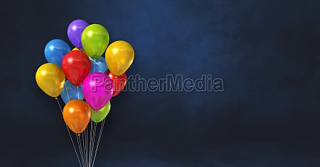 colorful balloons bunch on a black