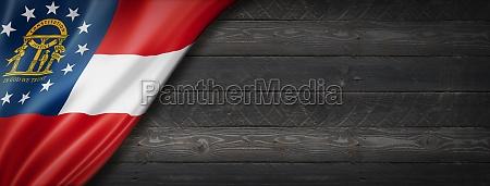 georgia flag on black wood wall