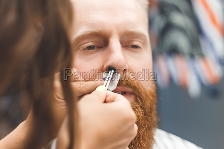 removing hair from the nose with