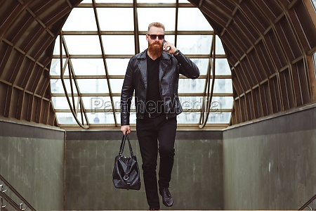 young caucasian bearded man fashionably dressed