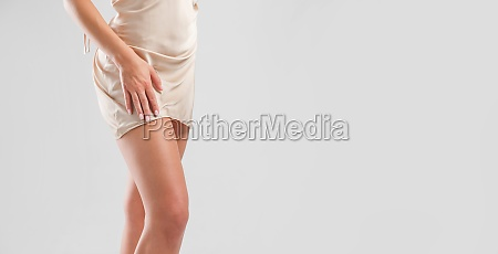 attractive legs of woman in silk