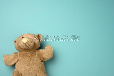 old teddy bear with a band