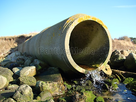 grey concrete cement drain pipe with