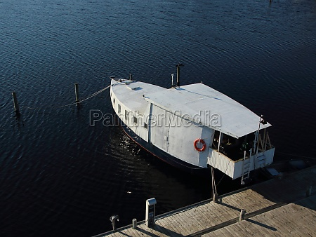 isolated boat at pier in aerial