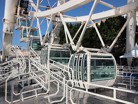 white solid ferris wheel cabins closeup