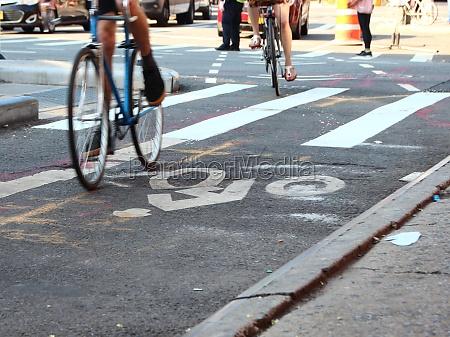 cyclists on bike lane with white