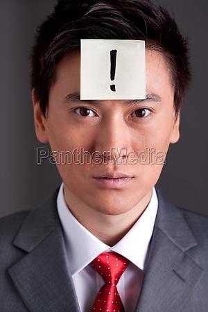 a white collar mans face