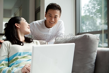 a couple using a laptop