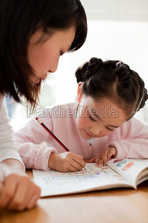 two people indoor education mother and