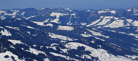 snow covered hills forest and farmland
