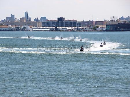 jet ski riders in harbor with