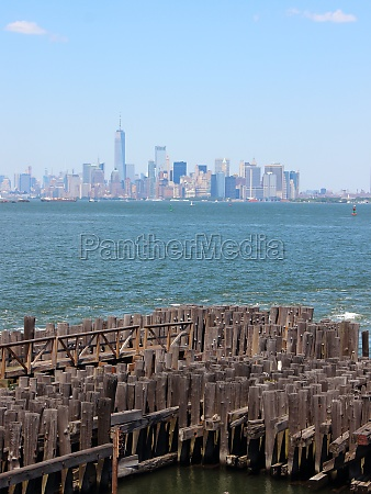 strong wooden pier with large tree