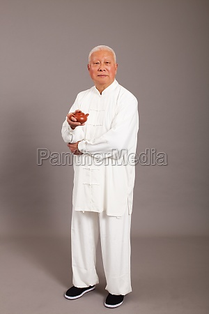 an elderly man dressed in traditional