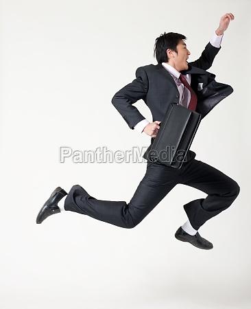 white collar workers jump work hard