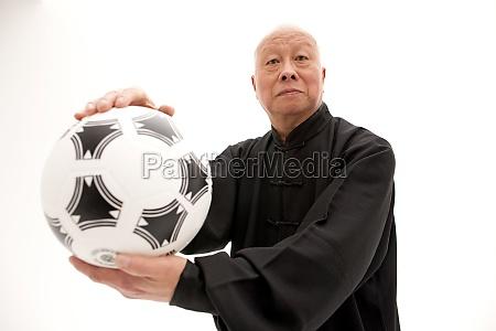an elderly tai chi
