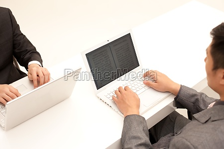 two male white collar workers with