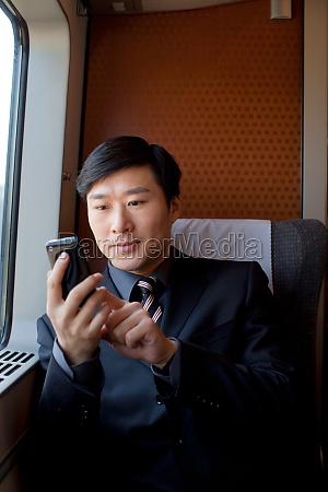the car texting travel a man
