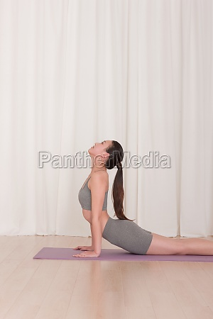 young woman yoga loose alone side