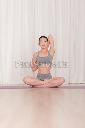 smile yoga mat slender cross legged