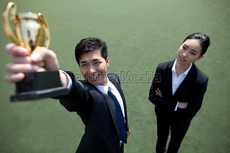 business people accept the award