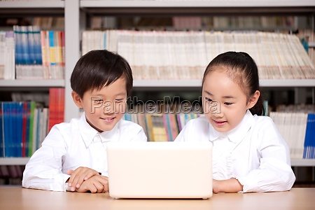 two students studying in photo gallery