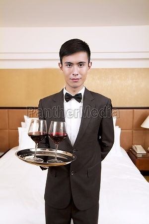 a waiter in a hotel service