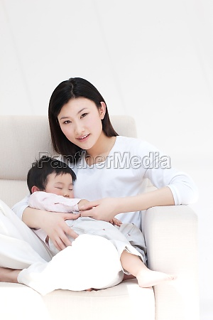 rest family embrace sleeping face the