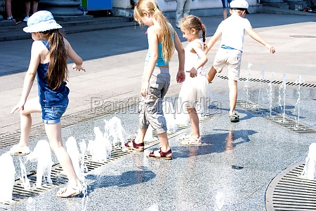 children playing with water at the