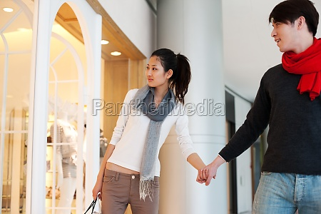 a couple at the mall shopping
